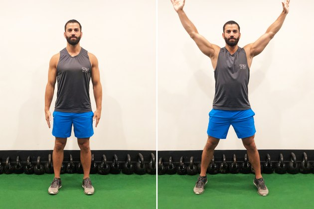 Man Doing Jumping Jacks During 20-Minute HIIT Workout