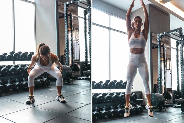 Woman doing squat jumps during a HIIT cardio workout