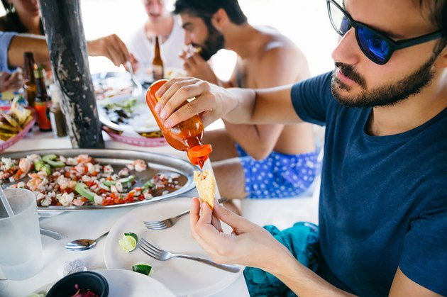sexy men eating ceviche