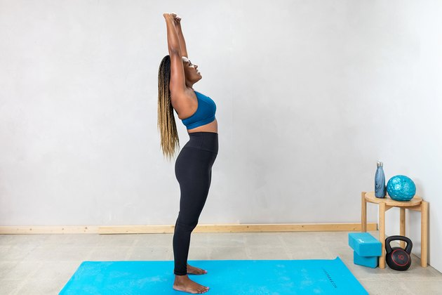 woman doing a standing ab stretch