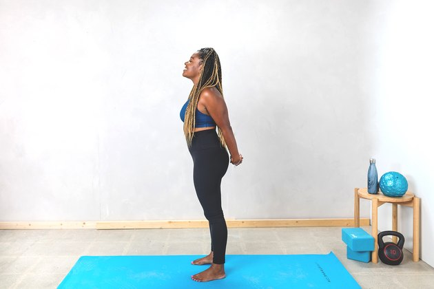 woman doing a chest and shoulder stretch