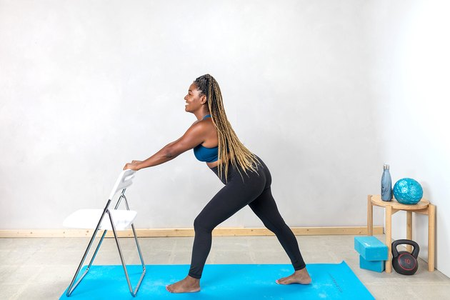 woman doing a standing calf stretch