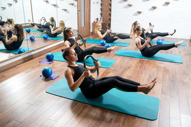 People doing Pilates workout for the benefits of Pilates