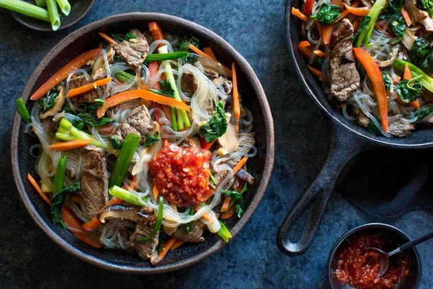 A bowl of Korean-style steak with glass noodles and stir-fried vegetables