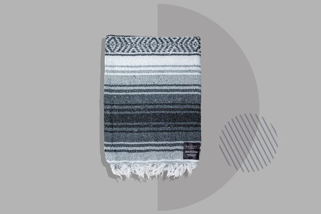 gray striped hand woven yoga blanket on gray background