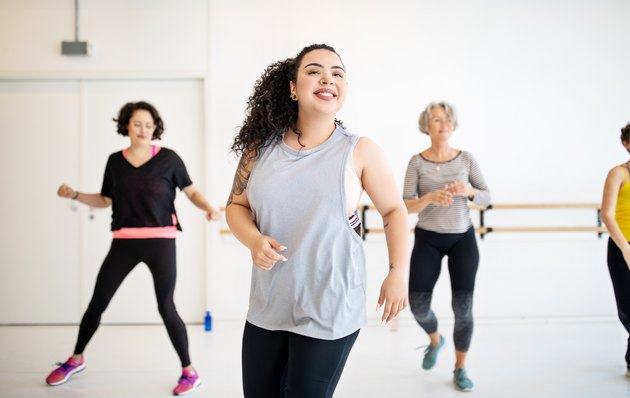 Woman learning dance moves in a class