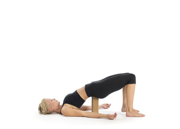 Passive bridge pose Setu Bandha Sarvangasana with yoga block