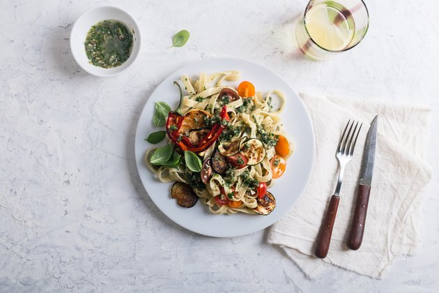 Fettucine with roasted  colorful vegetables and parsley  pesto