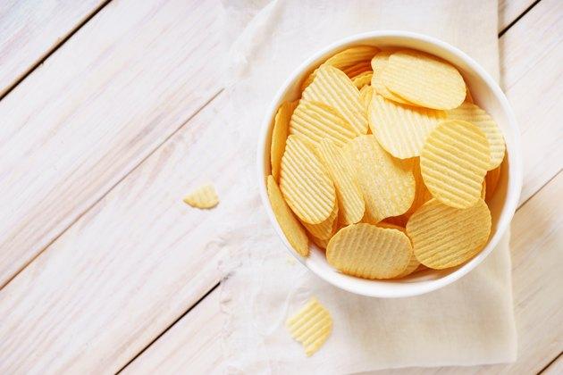 crispy potato chips in a white bowl