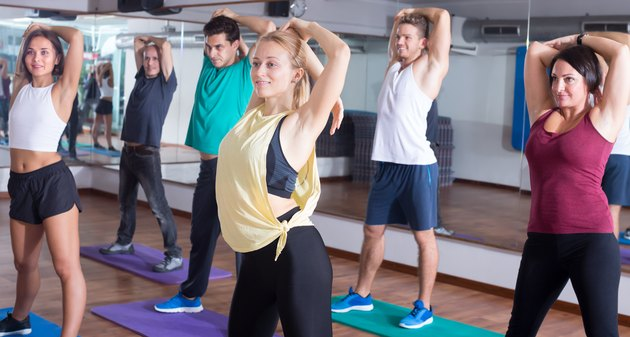Cheerful people learning zumba steps