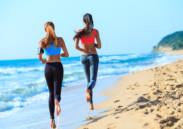 Two young women jogging on coastline