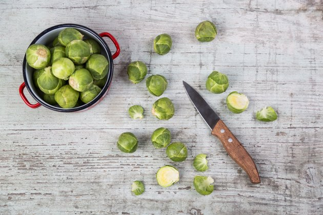 Brussels sprouts, kitchen knife and cooking pot