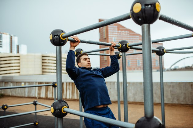 Man doing pull-ups as part of a CrossFit benchmark WOD
