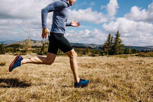 Man trail running wearing compression shorts