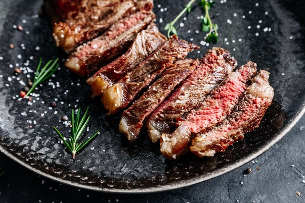 New York sirloin beef steak medium rare with rosemary top view