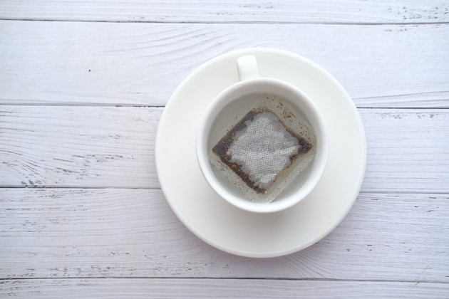 Top view of green tea and tea bag