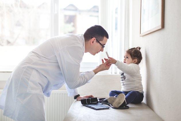 Doctor explaining procedure to little girl