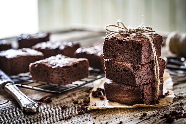 Homemade chocolate brownies shot on rustic wooden table