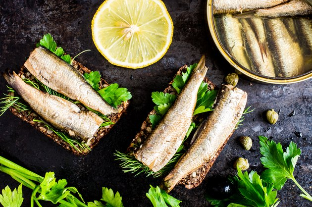 A sandwich with sardines and cilantro