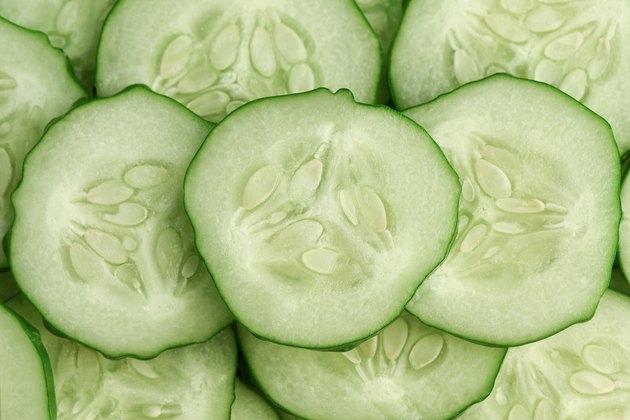 Fresh slice cucumber close-up background.