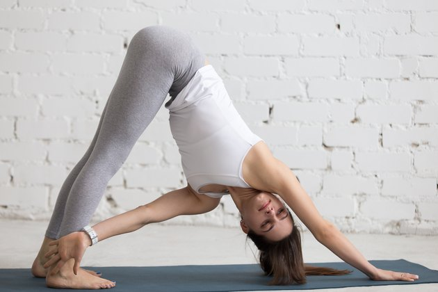 Yoga Indoors: Downward-facing dog pose with twist