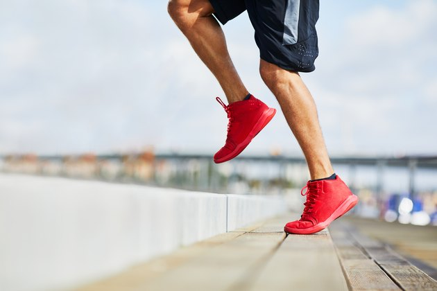 Closeup of athletic man doing HIIT workout outdoors