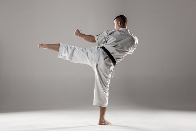 Man in white kimono training karate