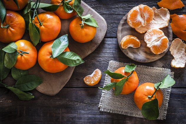 Fresh organic mandarins on rustic wooden table