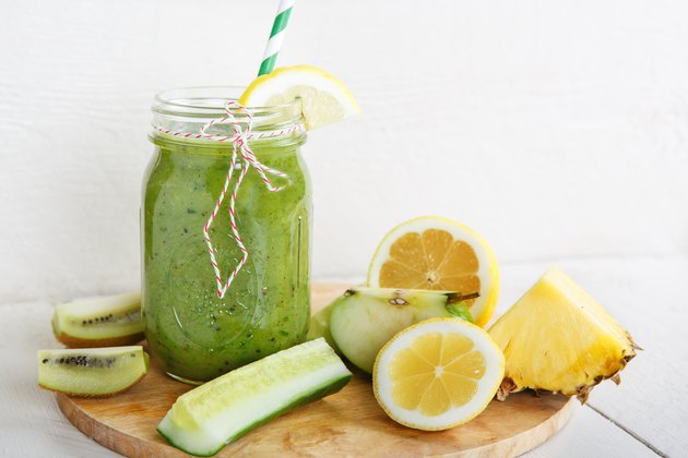 Fresh organic green smoothie with salad, apple, cucumber,