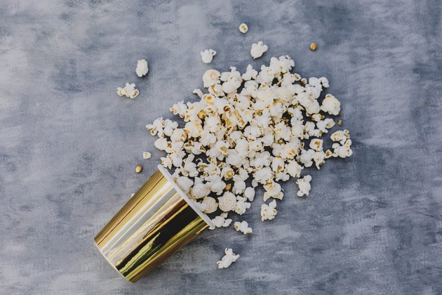 pop corn  in golden vase.Grey background