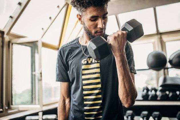Man performing proper biceps curl