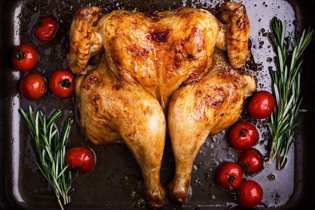 Butterflied roast chicken with  tomatoes and rosemary