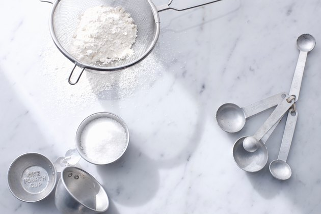 Flour with measuring cups and spoons