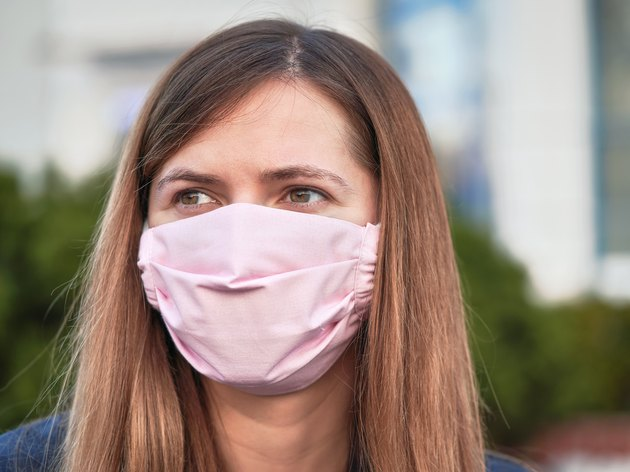 Young woman wearing pink homemade face mask