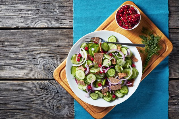 summer salad of cucumber, red currant, marinated red onion and crisp flatbread pieces