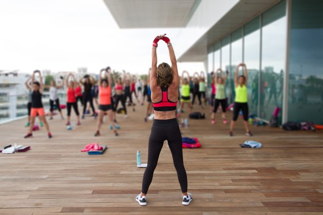 Female fitness trainer giving a class