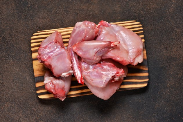 Fresh, raw rabbit meat on a concrete background. Organic food.