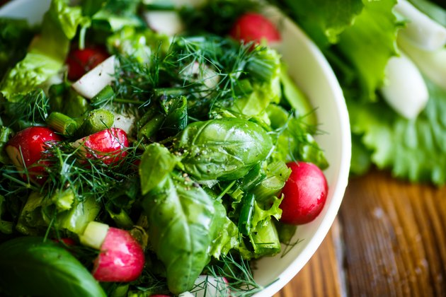 Spring salad from early vegetables, lettuce leaves, radishes and herbs