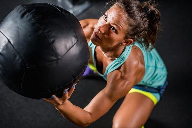 Female athlete, medicine ball exercise