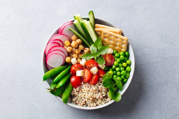 Healthy vegetarian salad. Buddha bowl. Grey stone background. Top view. Close up.