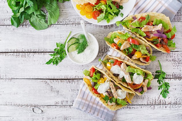 Mexican tacos with chicken, bell peppers, black beans