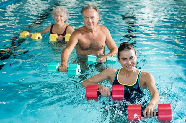 Gymnastics physiotherapy with dumbbells