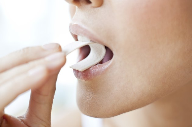 Young woman chewing gum