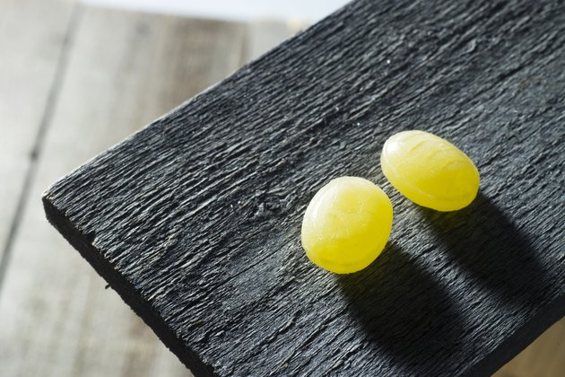 Cough Drops on Old Wooden Board