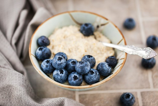 Close-up of oatmeal porridge with fresh blueberries for breakfast