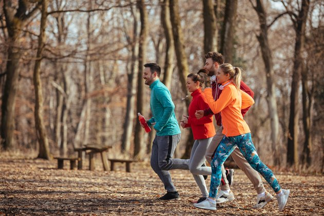 Group of friends jogging together outdoors