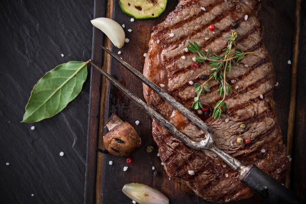 Delicious beef steak on black stone table