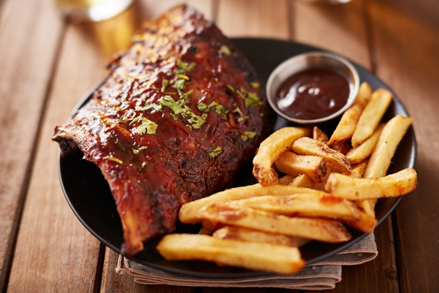 Half rack barbecue rib platter with french fries