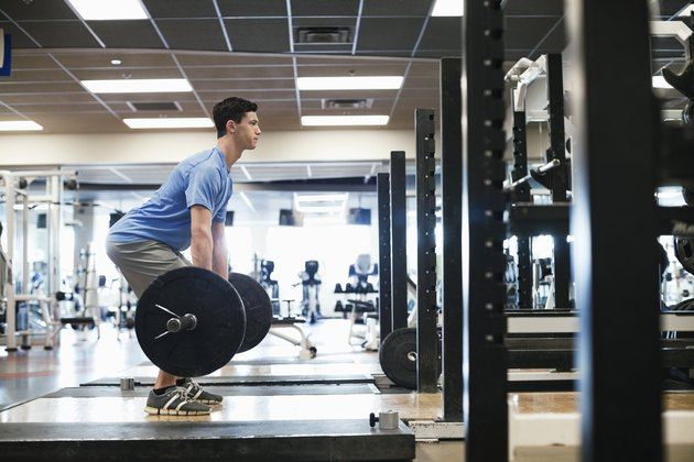 Man doing deadlifts in fitness center