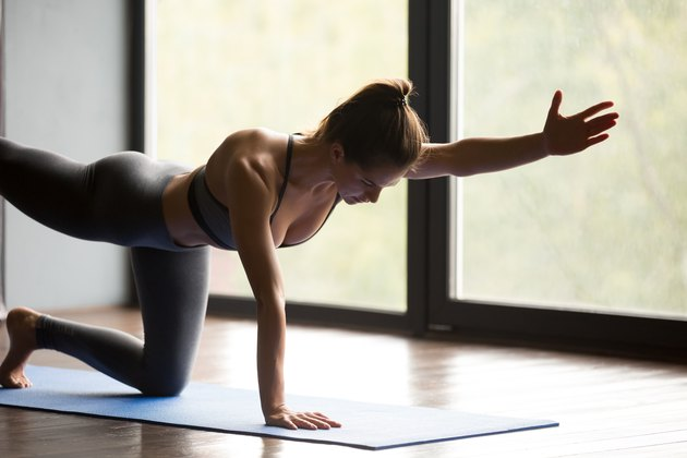 Young sporty woman doing Donkey exercise, close up